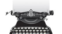 Máquina de escribir antigua con papel y texto